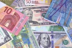 Abstrakt dollareuro- och schweizisk francbakgrund arkivfoto