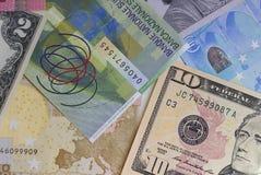 Abstrakt dollareuro- och schweizisk francbakgrund royaltyfri foto