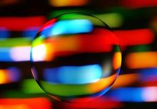 Abstrakt färgrik bakgrund med en genomskinlig sfär Royaltyfri Bild