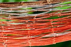 Abstrakt färgrik hängmatta i trädgård Arkivfoton