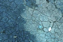 Abstrakt för sprickatextur för torr jord bakgrund Arkivfoto