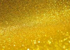 Abstrakt festlig säsongbakgrund av guld- blänker texturbakgrund Royaltyfri Bild