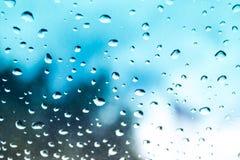 Abstrakt foto av vattendroppe på blåttspegeln Fotografering för Bildbyråer