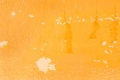 Abstrakt gammal gul Grungecementvägg för texturbakgrund Fotografering för Bildbyråer