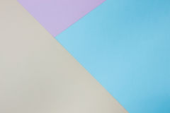 Abstrakt geometrisk pappers- bakgrund Blått rosa färger, orange trendfärger Royaltyfria Bilder