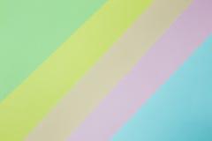 Abstrakt geometrisk pappers- bakgrund Göra grön, gulna, rosa färger, apelsinen, blått tenderar färger Fotografering för Bildbyråer