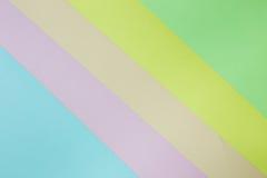 Abstrakt geometrisk pappers- bakgrund Göra grön, gulna, rosa färger, apelsinen, blått tenderar färger Royaltyfri Bild