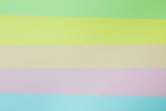 Abstrakt geometrisk pappers- bakgrund Göra grön, gulna, rosa färger, apelsinen, blått tenderar färger Arkivfoto