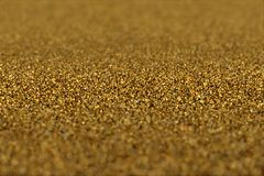 Abstrakt glamourbakgrund av blänker guld- partiklar fotografering för bildbyråer