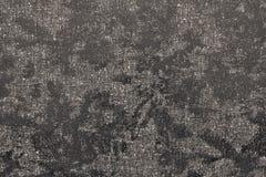 Abstrakt glansigt finnigt texturtyg av mörk beige färg Arkivfoto
