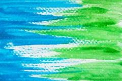 Abstrakt gräsplan- och blåttvattenfärgtextur royaltyfri bild