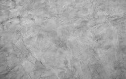 Abstrakt grå bakgrund av cementtextur med sprickan, bakgrund med betongväggen och stänger sig upp grov yttersida Arkivfoto