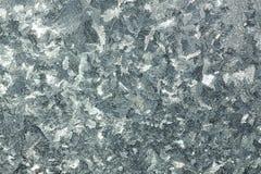 Abstrakt grå bakgrund från en frostig modell på exponeringsglas Royaltyfri Fotografi