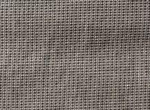Abstrakt grå textiltextur med modellen Arkivbilder