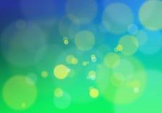 Grön bokeh tänder bakgrund Arkivfoton