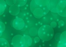 Abstrakt grön bokehsuddighetsbakgrund Royaltyfri Foto