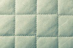 Abstrakt grön mjuk texturerad bakgrund med fyrkanter Fotografering för Bildbyråer