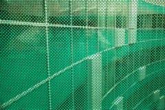 Abstrakt grönt exponeringsglas, med former av modern byggnad i backgrou Royaltyfri Fotografi