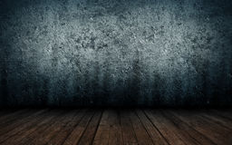 Abstrakt grungeinre av tomt rum med betongväggar Arkivbild