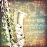 Abstrakt grungepianobakgrund med saxofonen Royaltyfria Foton