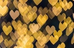 Abstrakt gul hjärtabokehbakgrund Arkivfoto