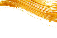 Abstrakt guld- bakgrund med akrylmålarfärgborsten med stället för din text arkivbild