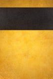Abstrakt guld- bakgrund med det svarta bandet Royaltyfria Foton