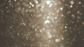 Abstrakt guld- bakgrund med flimrande partiklar för härligt sken Undervattens- bubblor i flöde med bokeh Royaltyfri Foto