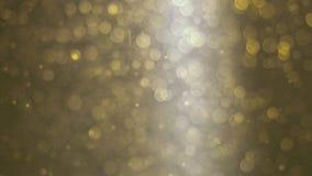 Abstrakt guld- bakgrund med härliga flimrande partiklar Undervattens- bubblor i flöde med bokeh Royaltyfria Foton