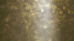 Abstrakt guld- bakgrund med härliga flimrande partiklar Undervattens- bubblor i flöde med bokeh Royaltyfri Foto