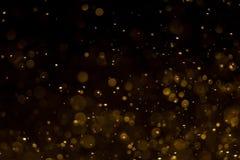 Abstrakt guld- bokeh med svart bakgrund arkivbilder