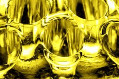 Abstrakt guld- glass bakgrund Arkivfoto