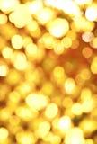 abstrakt guld- lampor Arkivfoto