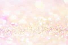 Abstrakt guld- ljus Bokeh bakgrundsguld Arkivfoto