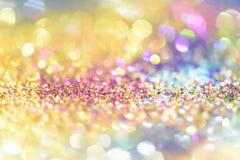 Abstrakt guld- ljus Bokeh bakgrundsguld Royaltyfri Foto