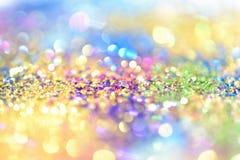 Abstrakt guld- ljus Bokeh bakgrundsguld Royaltyfria Bilder