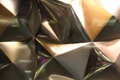 Abstrakt guld- triangeltextur Royaltyfria Bilder