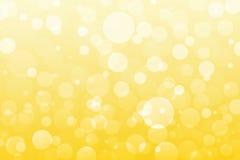 Abstrakt guling, guld- ljus, bokehbakgrund royaltyfri bild