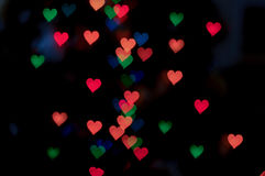 Abstrakt hjärtabokehbakgrund, bakgrund för dag för valentin` s Arkivbild