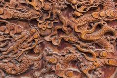 Abstrakt kinesisk modell på trä Arkivbild