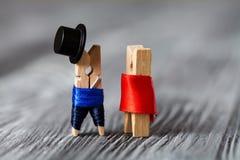 Abstrakt klädnypafamilj Man kvinna modell 3D Royaltyfria Foton