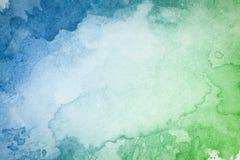 Abstrakt konstnärlig bakgrund för gräsplanblåttvattenfärg