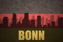 Abstrakt kontur av staden med text Bonn på den tyska flaggan för tappning Arkivfoton