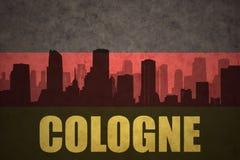 Abstrakt kontur av staden med text Cologne på den tyska flaggan för tappning Royaltyfri Bild