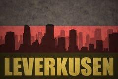 Abstrakt kontur av staden med text Leverkusen på den tyska flaggan för tappning Royaltyfria Bilder