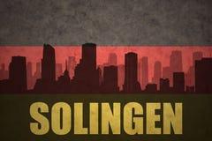 Abstrakt kontur av staden med text på den tyska flaggan för tappning Fotografering för Bildbyråer