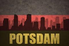 Abstrakt kontur av staden med text Potsdam på den tyska flaggan för tappning Royaltyfria Bilder