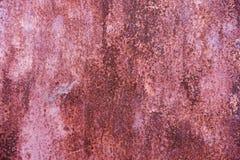 Abstrakt korodował kolorowego czerwonego ośniedziałego metalu tło, ośniedziały spotykający Obrazy Royalty Free