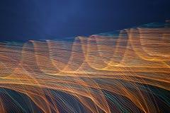 Abstrakt linje för ljus våg för natt Arkivfoto