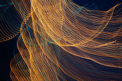 Abstrakt linje för ljus våg för natt Arkivfoton